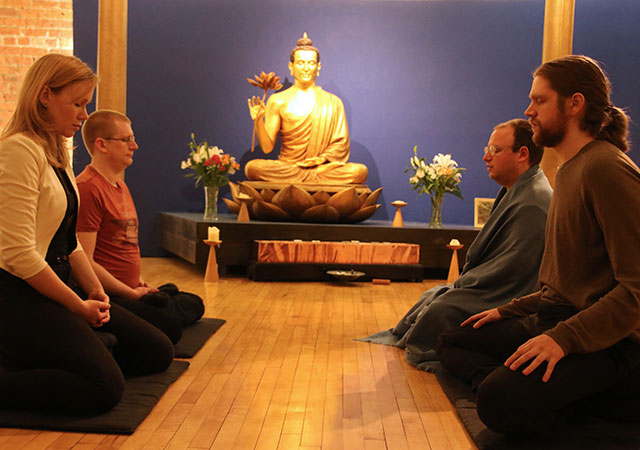 Photo of men and women meditating
