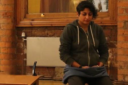 Woman Meditating in Lotus Hall