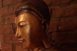 Standing Buddha statue detail