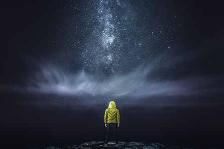 Man staring at night sky