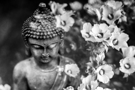 Buddha statue with flowers