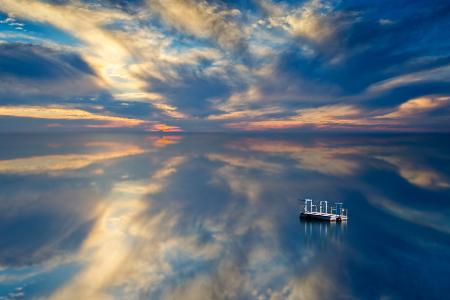 Body of water under blue sky
