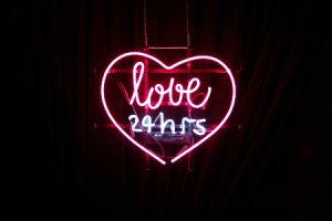 Neon love twenty four hours sign