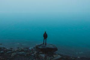 Man stood next to lake