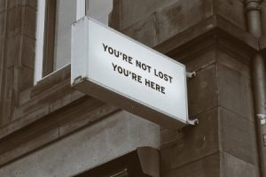 Sign saying 'you're not lost you're here'