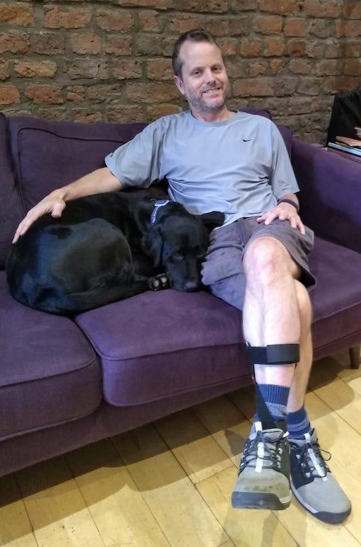 Tom - man on sofa with black dog