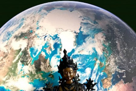 Buddha figure against background of globe