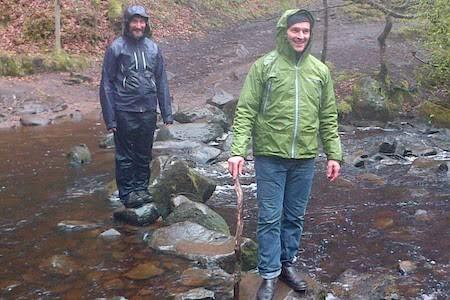 Men cross Stream in Rain