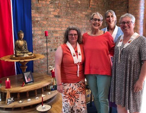 Four women with Buddhist shrine