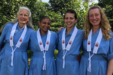Four women in blue ordination robes